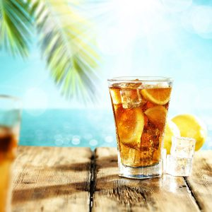Summer drink of ice tea and palm