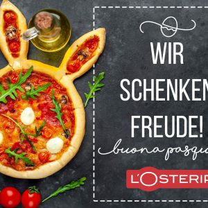 Easter pizza in the form of a hare with eggs, tomatoes, sunflowe